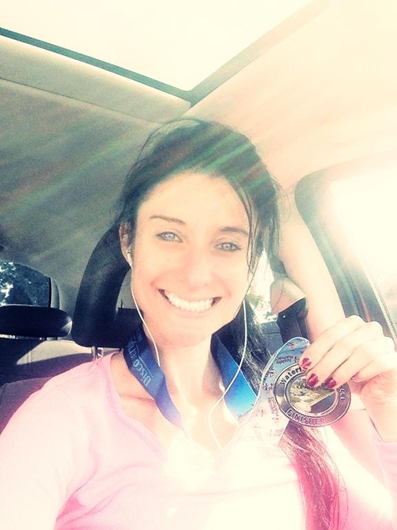 Bretta Riches (aka Run Forefoot) medal running in the Vibram Fivefingers