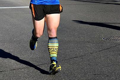Greater Work Demand on Knee in Heel Strike Running